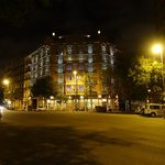 The view of the hotel at night from across the street.
