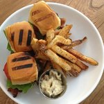 Sliders Three flame roasted angus beef sliders with blue cheese, Applewood bacon, truffle fries