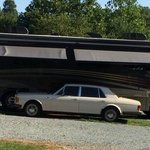 "You're ""ruffing it"" when you only bring the ""old"" Rolls Royce with you when you go camping"