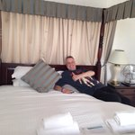 My hubby enjoying the comfort of the four poster bed!