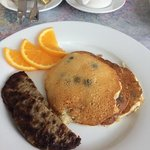 blueberry pancakes with sausage and orange slices