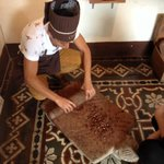 Alejandro is grinding cacao beans the Mayan way