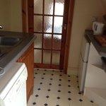 glass door from kitchen to bathroom