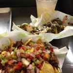 Short Ribs Nachos (front), Fried Brussel Sprouts, and Guava Limeade