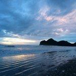Bethells beach sunset after rainy day