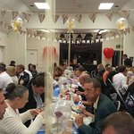 110 people happily enjoying fish and chips from Rainbow!