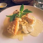 Pan fried bar fish with white wine sauce.