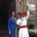 Veena Khandekar being welcomed at the fort with the traditional curved horn