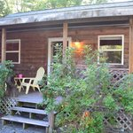 Front of cabin, covered porch, chairs and citronella candles provided
