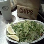 chipotle bowl with chips and soda