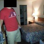 "tiny bed, mini ""hallway"" to sink room"