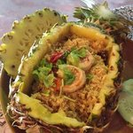 spicy seafood rice in a pineapple