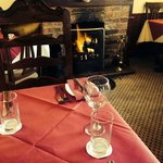 Sit and enjoy a meal next to our open fire