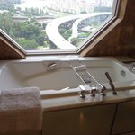 Inviting bubble bath with stunning city view