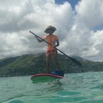 Standup paddle boarding after launching from down the street of Treehouse