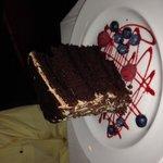 3 people split this large cake