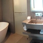 Bathroom with bath tub and separate shower and toilet