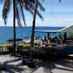 Veranda with sun beads, bar, TV and sitring area