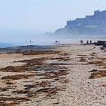 Bamburgh castle and beach on a misty morning