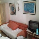 Plenty of storage, dated decor, a third 'bed/sofa' and the old TV.
