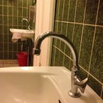 Ladies toilet bathroom sinks in Unit U only have cold water faucets. Must go down the hall to sh