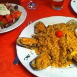 Giant mussels on mussel risotto and Greek salad