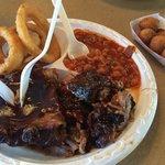 Pork ribs, rough chopped BBQ, hush puppies, onion rings, baked beans