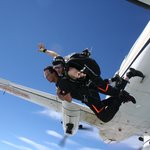 Exiting the airplane from 13000 feet on a tandem skydive