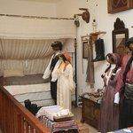 Bed and traditional costumes