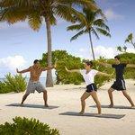Yoga class on the beach (109897570)