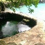 Fresh water rock pool against ocean lagoon