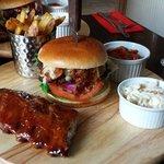 Main consisting of half rack of Jack Daniels honey glaze baby back ribs and Beef Burger
