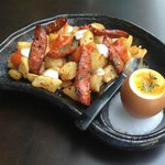 Potatoes with sausages and oven baked egg