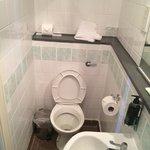 Left side of toilet/shower room