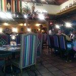 Bright, pleasant decor with tables....