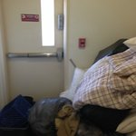 Dangerous stairwell- Disgusting linens blocking door