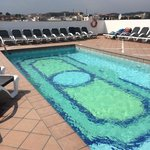 Roof top pool (max depth 1.45m)rather small with sun beds to accommodate around 25-30. Can get a