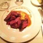 Sliced ribeye steak with corn
