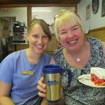 Laurie and our server Jena showing off her new mug and favorite raspberry sour cream pie...
