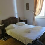 Comfortable double bed with good lighting & outlets