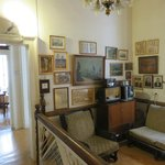 The parlor with old radio and phohtographs