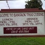 Bangkok Thai Cuisine sign including hours and phone for reservations.