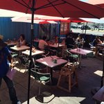 """Main outdoor seating. We were at one of two tables on a """"deck""""."""