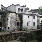 White-washed houses along Longmen stream that cut through the center of the town.