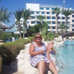 enjoying a drink on the rocks by the pool