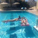 Clean sparkling pool, plenty of deckchairs