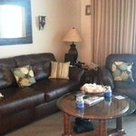 Unit 703 with newly added sofa and chair in living room