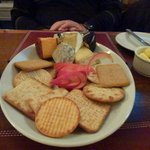 a plate of Welsh cheeses with a gander