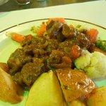 pork stew on very small plate