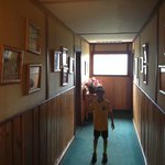 Old pictures line the creaky hallways